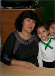 Сатирова Евгения Михайловна, стаж работы 31 год, образование высшее, соответствие занимаемой должности